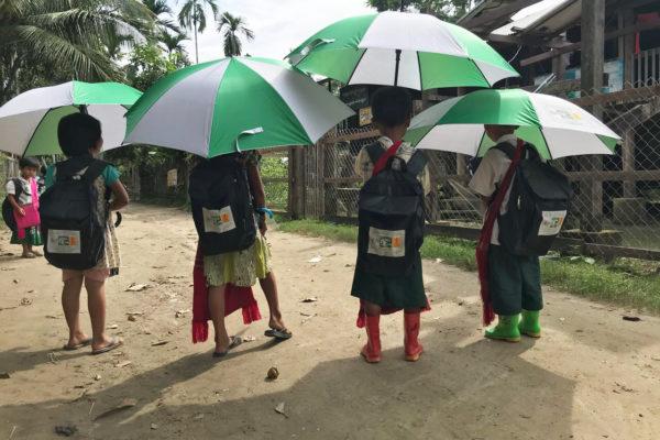 children with donated school supplies